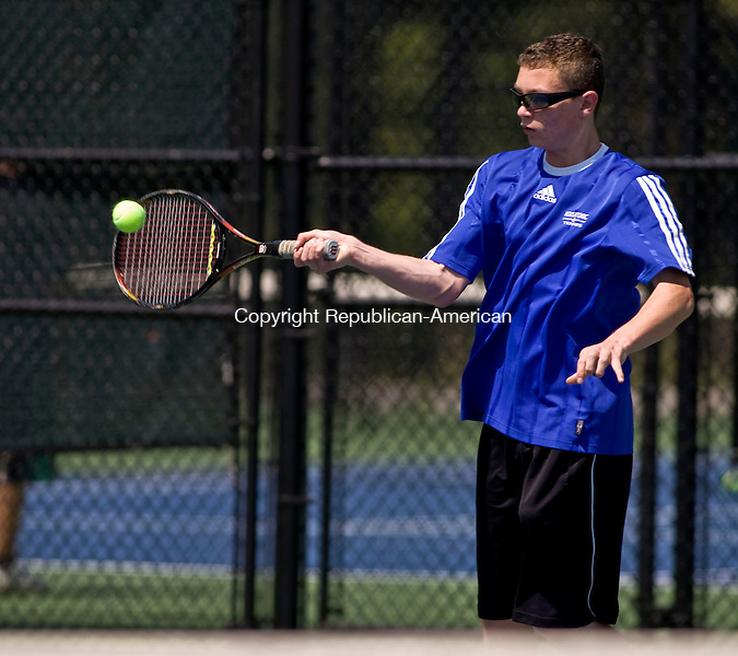 LAKEVILLE, CT - 21 MAY 2010 -052110JT04-<br /> Housatonic's Matt Walker returns the ball to Wamogo's Mark Davis during Friday's Berkshire League Tennis Championship at the Hotchkiss School in Lakeville.<br /> Josalee Thrift Republican-American