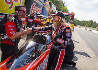May 17, 2015; Commerce, GA, USA; NHRA top fuel driver Leah Pritchett with crew members during the Southern Nationals at Atlanta Dragway. Mandatory Credit: Mark J. Rebilas-USA TODAY Sports