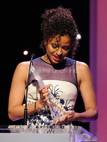 BEVERLY HILLS, CA -  FEBRUARY 19: <br /> Gugu Mbatha-Raw accepts the Lincoln Breakthrough of the Year Award onstage at the 8th Annual Essence Black Women in Hollywood luncheon at the Beverly Wilshire Hotel on February 19, 2015 in Beverly Hills, California. Credit: PGFM/MediaPunch