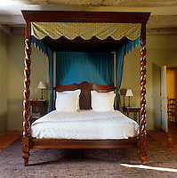 A grand four-poster bed takes centre stage in the bedroom