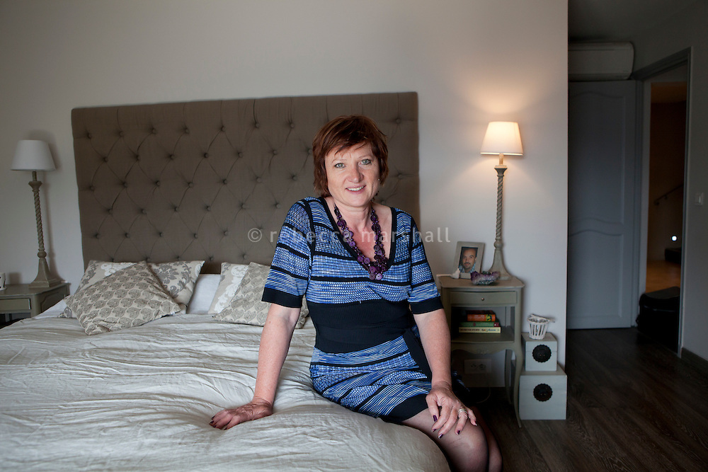 Nicole Bekdache poses for the photographer in the master bedroom at her home, Grasse, France, 30 March 2012.