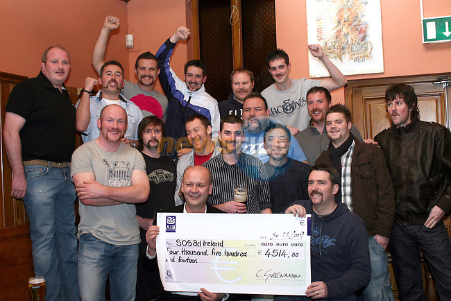 Damien Martin, Shane Martin, Andy Coyle, Tom Carroll, Darragh Smith, Lee Moroney, Tom Ruddy, Eoin Collins, Ciaran Grennan, Peter Smith, Fergal Cooney, Barry Crinion, Paddy Cooney, Hank, Aaron Hatch, James Fay and Dave Kearney (not in pic) pictured here presenting cheque to Peter Moroney of SOSAD on the Last Day of the Moustache, Goatee and other facial hair growing in aid of SOSAD...Photo NEWSFILE/Jenny Matthews.(Photo credit should read Jenny Matthews/NEWSFILE)....This Picture has been sent you under the condtions enclosed by:.Newsfile Ltd..The Studio,.Millmount Abbey,.Drogheda,.Co Meath..Ireland..Tel: +353(0)41-9871240.Fax: +353(0)41-9871260.GSM: +353(0)86-2500958.email: pictures@newsfile.ie.www.newsfile.ie.FTP: 193.120.102.198.