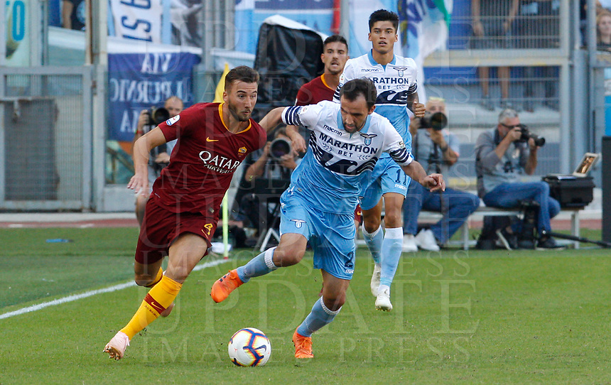 Roma's Stephan El Shaarawy, left, is challenged by Lazio's Milan Badelj during the Italian Serie A football match between Roma and Lazio at Rome's Olympic stadium, September 29, 2018. Roma won 3-1.<br /> UPDATE IMAGES PRESS/Riccardo De Luca