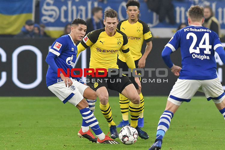 08.12.2018, Veltins-Arena, Gelsenkirchen, GER, 1. FBL, FC Schalke 04 vs. Borussia Dortmund, DFL regulations prohibit any use of photographs as image sequences and/or quasi-video<br /> <br /> im Bild v. li. im Zweikampf Amine Harit (#25, FC Schalke 04) Lukasz Piszczek (#26, Borussia Dortmund) <br /> <br /> Foto © nordphoto/Mauelshagen