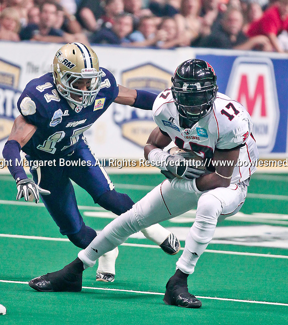 Aug 14, 2010: Orlando Predator wide receiver Antoine Toliver (#17) goes on-one-one against Tampa Bay Storm defensive back Brandon Hefflin (#17). The Storm defeated the Predators 63-62 to win the division title at the St. Petersburg Times Forum in Tampa, Florida. (Mandatory Credit:  Margaret Bowles)