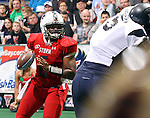 SIOUX FALLS, SD - MARCH 17:  Roy Polite #6 from the Sioux Falls Storm looks for a receiver against the Wyoming Calvary in the second quarter of their game Sunday afternoon at the Sioux Falls Arena. (Photo by Dave Eggen/Inertia)