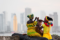 Afro-Colombian girls, dressed in the traditional 'palenquera' costume, create a braided hairstyle for a female tourist on the stone walls in Cartagena, Colombia, 11 December 2017. With the peace agreement, ending a 52-year civil conflict and promising political stability, together with rapid economic growth and unexploited tourism potential, Colombia has truly become a holiday destination. Cartagena, a UNESCO World Heritage site on the tropical Caribbean coast, plays the primary role in Colombia's tourism renaissance. The historic sites from the Spanish colonial times are being restored, private investments are visible throughout the city and an increased number of local people benefit from the boom of the travel related services.