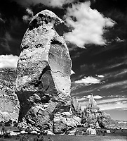 """""""Chimney Rock""""<br /> Kodachrome Basin State Park, Utah<br /> 2019<br /> <br /> Kodachrome has nearly 70 of these monolithic spires called sedimentary pipes.  Standing at around 170 feet, Chimney Rock is the largest spire in the state park.  <br /> Kodachrome Basin was given it's name in 1948 by visitors from the National Geographic Society who were inspired by the colors of the surrounding landscape and naming it after the famous color film.<br /> Wanting to highlight the lines and textures of the tower against horizontal lines of the background rock and the dark blue sky, I decided to use B&W film for creating this image."""
