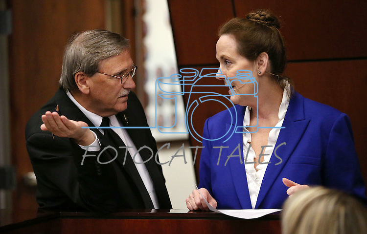 Nevada Assemblyman John Ellison, R-Elko, talks with Chief Clerk Susan Furlong on the Assembly floor at the Legislative Building in Carson City, Nev., on Thursday, May 7, 2015.<br /> Photo by Cathleen Allison