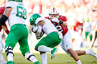 STANFORD, CA - SEPTEMBER 21: Casey Toohill #52 of the Stanford Cardinal tackles CJ Verdell #7 of the Oregon Ducks during a game between University of Oregon and Stanford Football at Stanford Stadium on September 21, 2019 in Stanford, California.