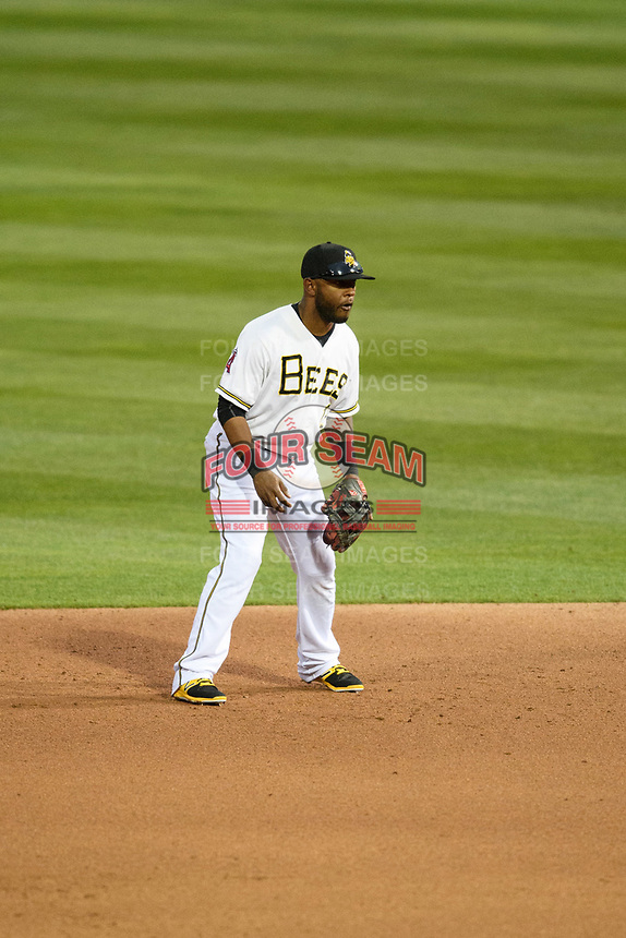 Rey Navarro (13) of the Salt Lake Bees on defense against the Sacramento River Cats in Pacific Coast League action at Smith's Ballpark on April 11, 2017 in Salt Lake City, Utah.  The River Cats defeated the Bees 8-7. (Stephen Smith/Four Seam Images)