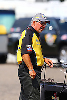 Aug 16, 2014; Brainerd, MN, USA; A member of the Safety Safarai during qualifying for the Lucas Oil Nationals at Brainerd International Raceway. Mandatory Credit: Mark J. Rebilas-