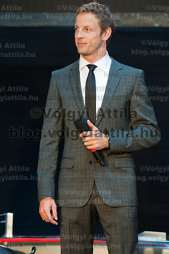McLaren Formula One driver Jenson Button of Britain talks on stage during the annual Hugo Boss party just prior to the Hungarian F1 Grand Prix in Budapest, Hungary. Thursday, 28. July 2011. ATTILA VOLGYI