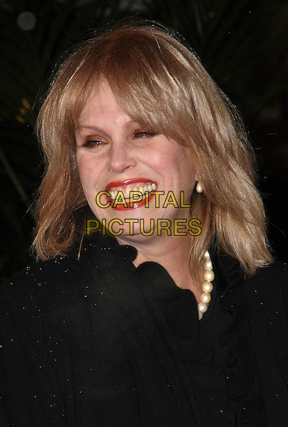 JOANNA LUMLEY .Gala VIP Opening Night of Cirque du Soleil's 'Varekai' at the Royal Albert Hall, London, England, UK, January 5th 2010..arrivals portrait headshot black smiling teeth lipstick make-up funny eyeshadow  .CAP/JIL.©Jill Mayhew/Capital Pictures