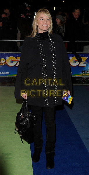 "TAMZIN OUTHWAITE.The Press Night for the new musical stage production of the ""Wizard of Oz"", London Palladium, London,.England, UK..March 1st, 2011.full length black coat bag poncho trousers .CAP/CAN.©Can Nguyen/Capital Pictures."