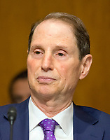 "United States Senator Ron Wyden (Democrat of Oregon) listens as US Secretary of the Treasury Steven T. Mnuchin, gives testimony before the US Senate Committee on The Budget ""on the Presidentís FY 18 Budget and Revenue Proposals Featuring Treasury"" on Capitol Hill in Washington, DC on Tuesday, June 13, 2017. Photo Credit: Ron Sachs/CNP/AdMedia"