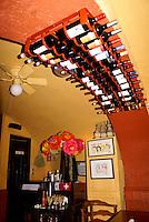 Wine bottles in a restaurant, San Miguel de Allende, Mexico. San Miguel de Allende is a UNESCO World Heritage Site....