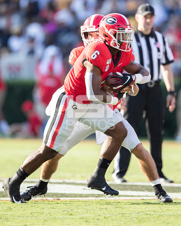 ATHENS, GA - SEPTEMBER 7: Kenny McIntosh #6 receives a handoff from Georgia Quarterback Stetson Bennett #13 during a game between Murray State Racers and University of Georgia Bulldogs at Sanford Stadium on September 7, 2019 in Athens, Georgia.