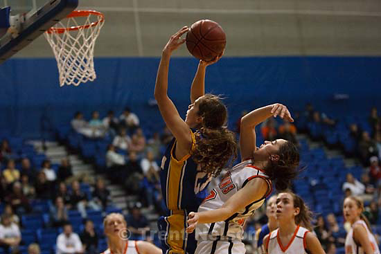 Taylorsville - Murray vs. Orem High School girls basketball at the 4A State Tournament Tuesday February 24, 2009 at Salt Lake Community College. Orem's Maggie Plothow Murray's Meliame White