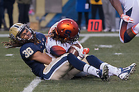 Pitt defensive back Ryan Lewis (38) makes a tackle on a kickoff.  The Pitt Panthers defeated the Syracuse Orange 30-7 at Heinz Field, Pittsburgh, Pennsylvania on November 22, 2014.