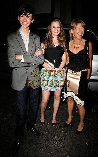 THOMAS SANGSTER, GUEST & JULIA DUFF.The new G-Shock launch party, 24 London nightclub, Kingly St., London, England..June 11th, 2009.full length black corset top pink beige silk satin skirt ruffled ruffles jeans denim grey gray jacket shirt arms crossed blue pink floral print mother mom mum son family.CAP/CAN.©Can Nguyen/Capital Pictures.
