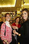 "Fans Tracey & Kathy buy 2 necklaces - one silver and one gold from Days' Kristen Alfonso jewelry line Hope - Faith - Miracles on November 29, 2008 at Bloomingdales, New York City, New York. ""The fleur de lis has been the symbol of my inspiration. It has brought me hope and the faith to believe in miracles."" (Photo by Sue Coflin/Max Photos)"