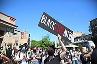 NEW YORK, NEW YORK - MAY 30: A Protestor holds a sign as he takes part during a protest against police in response to the police officer who killed George Floyd in Brooklyn on May 30, 2020 in New York. protests spread nationwide in at least 30 US cities over the death of unarmed black man George Floyd at the hands of a police (Photo by Pablo Monsalve/ VIEWpress via Getty Images)