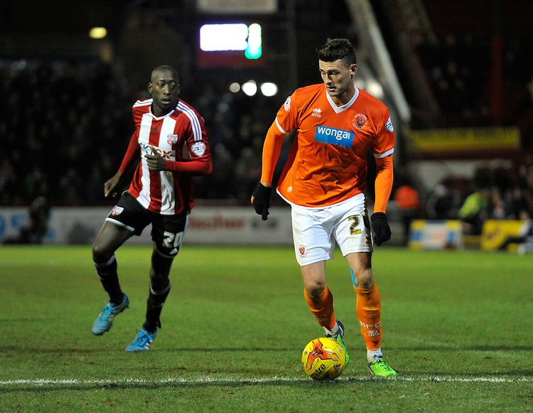 Blackpool's Gary Madine holds off the challenge from Brentford's Toumani Diagouraga<br /> <br /> Photographer Ashley Western/CameraSport<br /> <br /> Football - The Football League Sky Bet League One - Brentford v Blackpool - Tuesday 24th February 2015 - Griffin Park - London<br /> <br /> &copy; CameraSport - 43 Linden Ave. Countesthorpe. Leicester. England. LE8 5PG - Tel: +44 (0) 116 277 4147 - admin@camerasport.com - www.camerasport.com