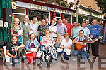 Killarney musicians busking for charity at Market Cross Killarney on Monday were front row l-r: Dan McCarthy, Linda Quirke, Mary Murphy, Nora O'Sullivan, Alice Fitzgerald, Clifford Fee. Back row: Mary O'Connor, Pat O'Neill, Damian O'Meara, Timmy and Kay Fleming, Jimmy Canty, Frank Culloty, Ted Ahern, Ger Brosnan, Joe Quinlan, Rory Sugrue, Teddy Sugrue, and Dermot Moynihan