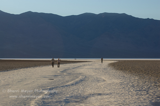 Tourists exploring Badwater Basin, Death Valley National Park, California