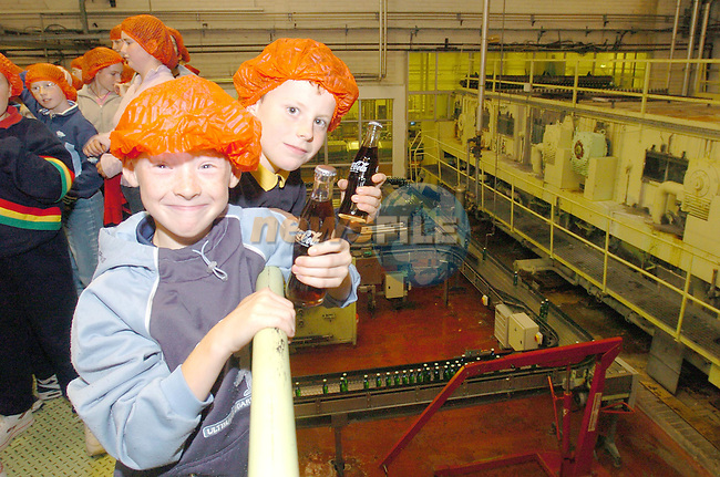 Eoin Lynch and Sean Kinealy watching the Coke Bottles being filled during there visit to the Coca Cola Bottlers in Dublin organised by Drogheda Concentrates...Photo Fran Caffrey Newsfile.ie..This Picture has been sent to you by Newsfile Ltd..The Studio,.Millmount Abbey,.Drogheda,.Co. Meath,.Ireland..Tel: +353(0)41-9871240.Fax: +353(0)41-9871260.ISDN: +353(0)41-9871010.www.newsfile.ie..general email: pictures@newsfile.ie