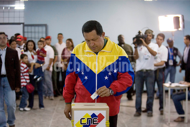 Venezuelan President Hugo Chavez casts his vote during parliamentary elections in Caracas September 26, 2010.