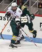 Adam Reid (NU - 8), Alexx Privitera (UVM - 18) - The visiting University of Vermont Catamounts defeated the Northeastern University Huskies 6-2 on Saturday, October 11, 2014, at Matthews Arena in Boston, Massachusetts.