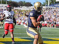 Annapolis, MD - September 23, 2017: Navy Midshipmen wide receiver Tyler Carmona (88) catches a touchdown during the game between Cincinnati and Navy at  Navy-Marine Corps Memorial Stadium in Annapolis, MD.   (Photo by Elliott Brown/Media Images International)