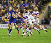 23rd March 2018, Halliwell Jones Stadium, Warrington, England; Betfred Super League rugby, Warrington Wolves versus Wakefield Trinity; Daryl Clark attracts the attention of Scott Grix (centre)