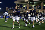 DURHAM, NC - APRIL 28: Notre Dame's William Young (left), Anthony Marini (4), and Bobby Gray (44) lead their teammates onto the field. The Duke University Blue Devils played the University of Notre Dame Fighting Irish on April 28, 2017, at Koskinen Stadium in Durham, NC in a 2017 ACC Men's Lacrosse Tournament Semifinal match. Notre Dame won the game 7-6.