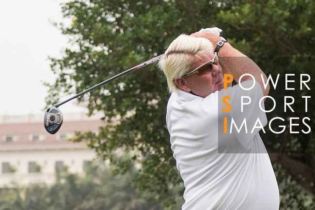 John Daly tees off the 1st hole during the World Celebrity Pro-Am 2016 Mission Hills China Golf Tournament on 23 October 2016, in Haikou, China. Photo by Weixiang Lim / Power Sport Images