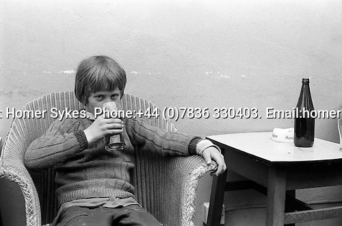 Young boy underage drinking. Pub public house in  Bellerby, Yorkshire England 1973