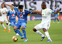 BOGOTA -COLOMBIA. 02-02-2014. Jhonatan Agudelo (Izq) de Millonarios  disputa el balon contra Wilmer Diaz de La Equidad durante el partido por la segunda fecha de La liga Postobon 1 disputado en el estadio El Campin. / Jhonatan Agudelo (L ) of  Millonarios fights for the ball against Wilmer Diaz of  La Equidad  during the match for the second date of the Postobon one league match at El Campin  Stadium Photo: VizzorImage/ Felipe Caicedo / Staff