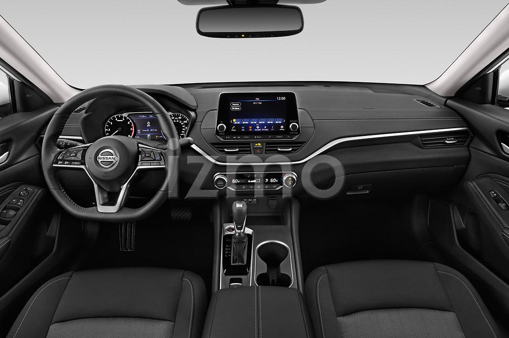 Stock photo of straight dashboard view of 2020 Nissan Altima SV 4 Door Sedan Dashboard