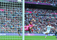 August 07, 2012..Japan's Shuichi Gonda attempts to save a goal scored by Mexico's Oribe Peralta (not in the picture) during second half of Semi Final match at the Wembley Stadium on day eleven in Wembley, England. Mexico defeat Japan 3-1 to reach Men's Finals of the 2012 London Olympics...
