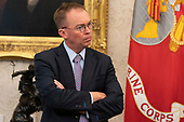 Acting White House Chief of Staff and Director of the Office of Management and Budget (OMB) Mick Mulvaney listens as United States President Donald J. Trump meets with His Royal Highness Prince Salman bin Hamad Al-Khalifa, Crown Prince, Deputy Supreme Commander, and First Deputy Prime Minister of the Kingdom of Bahrain in the Oval Office of the White House in Washington, DC.<br /> Credit: Chris Kleponis / Pool via CNP