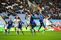Chey Dunkley of Wigan Athletic vies for possession with George Byers of Swansea City during the Sky Bet Championship match between Wigan Athletic and Swansea City at The DW Stadium in Wigan, England, UK. Saturday 2 November 2019