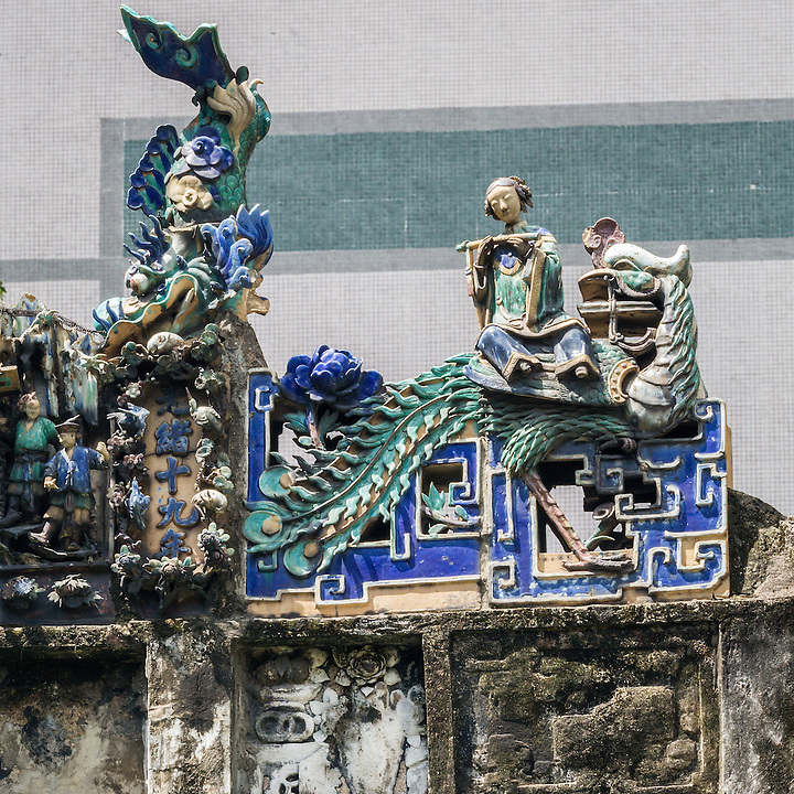 """The Decorative Motifs On The Ridge Mainly Relate To Chinese Traditional Stories.  This Depicts """"Music For The Phoenix""""."""