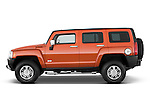 Driver side profile view of a 2008 Hummer H3 Alpha SUV.