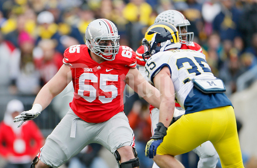 Ohio State Buckeyes offensive lineman Pat Elflein (65) against Michigan Wolverines at Ohio Stadium in Columbus, Ohio on November 29, 2014.  (Dispatch photo by Kyle Robertson)