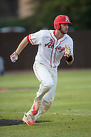 Thomas Yoder (20) of the Belmont Abbey Crusaders hustles down the first base line against the Catawba Indians at Abbey Yard on February 7, 2017 in Belmont, North Carolina.  The Crusaders defeated the Indians 12-9.  (Brian Westerholt/Four Seam Images)