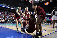 GREENSBORO, NC - MARCH 07: Emma Guy #11 of Boston College is helped up by teammates Georgia Pineau #5, Taylor Ortlepp #4, and Taylor Soule #13 during a game between Boston College and NC State at Greensboro Coliseum on March 07, 2020 in Greensboro, North Carolina.