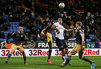 Bolton Wanderers' Josh Magennis competing with Sheffield Wednesday's Michael Hector <br /> <br /> Photographer Andrew Kearns/CameraSport<br /> <br /> The EFL Sky Bet Championship - Bolton Wanderers v Sheffield Wednesday - Tuesday 12th March 2019 - University of Bolton Stadium - Bolton<br /> <br /> World Copyright © 2019 CameraSport. All rights reserved. 43 Linden Ave. Countesthorpe. Leicester. England. LE8 5PG - Tel: +44 (0) 116 277 4147 - admin@camerasport.com - www.camerasport.com