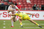 Simon Kennewell of Australia tries to tackle Callum Sirker of England who runs with the ball during the match Australia vs England, the Bronze Final of Day 2 of the HSBC Singapore Rugby Sevens as part of the World Rugby HSBC World Rugby Sevens Series 2016-17 at the National Stadium on 16 April 2017 in Singapore. Photo by Victor Fraile / Power Sport Images